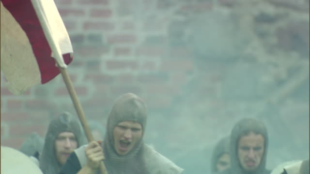 cu, slo mo, selective focus, reenactment medieval crusaders running holding flag, vilnius, lithuania - the crusades stock videos & royalty-free footage