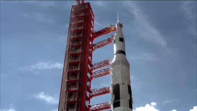 reenactment medium shot low angle crane shot looking up at rocket on launch pad / johnson space center, texas - ロケット点の映像素材/bロール