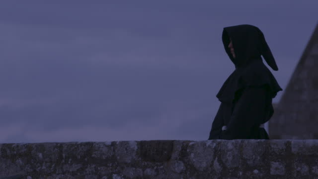 reenactment of benedictine monk at twilight - monk stock videos & royalty-free footage