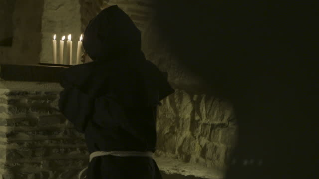 reenactment of benedictine monk praying in candlelight - monk stock videos & royalty-free footage