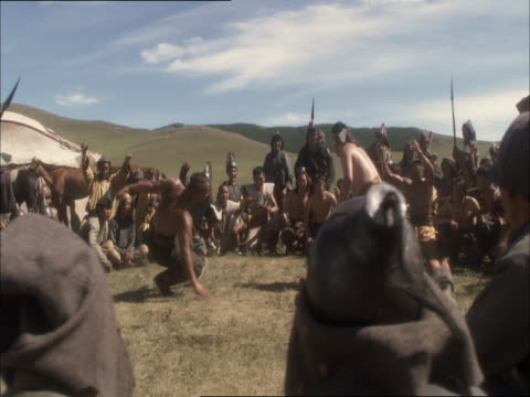 re-enactment of genghis khan sitting and watching tribesmen wrestle - reenactment stock videos & royalty-free footage