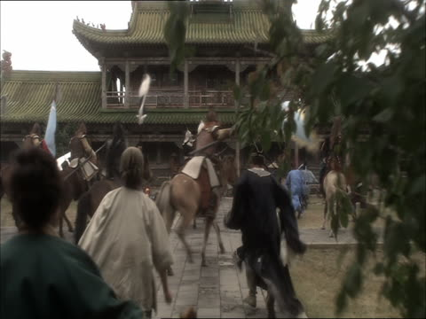 re-enactment of genghis khan's army breaking through fortress wall to capture beijing after fierce battle - reenactment stock videos & royalty-free footage