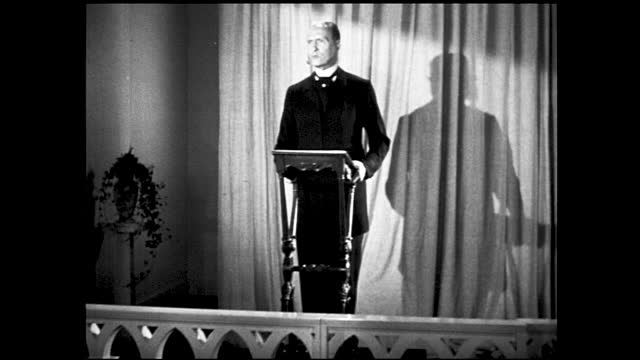 """vidéos et rushes de reenactment of man and woman listening to enos barton speaking on hopes for a """"greater and greater tomorrow"""" inside theater - 1940 1949"""
