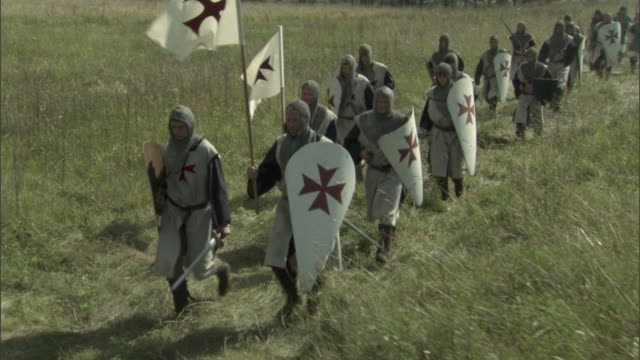 cs, pan, reenactment of medieval crusaders passing through field, vilnius, lithuania - the crusades stock videos & royalty-free footage