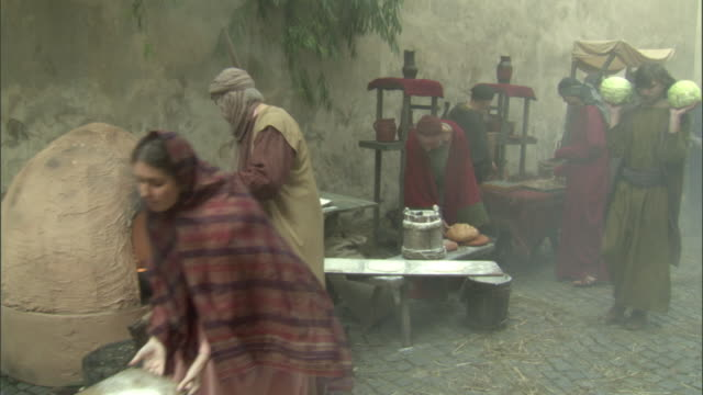 ms, pan, reenactment of people at medieval outdoor market, vilnius, lithuania - reenactment stock videos and b-roll footage