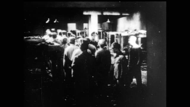 / reenactment of prisoners lined up in large cell full of bunk beds led out of the room by nazi soldier prisoners lined up by nazis on january 01... - nazi germany stock videos and b-roll footage