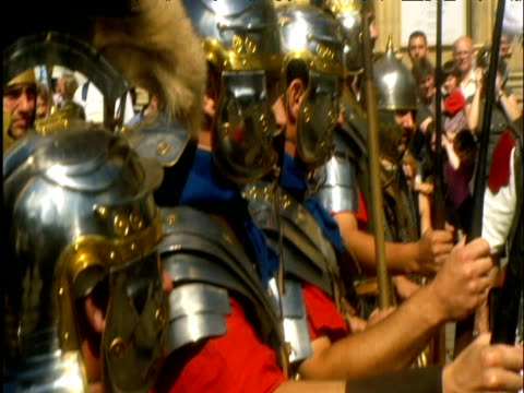 reenactment of roman soldiers honouring constantine york - traditional helmet stock videos and b-roll footage
