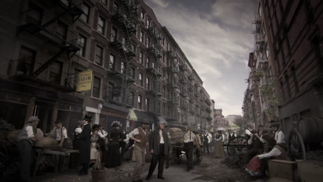 reenactment sequence depicting a street in the five points district of new york city in the 19th century. - neunzehntes jahrhundert stock-videos und b-roll-filmmaterial