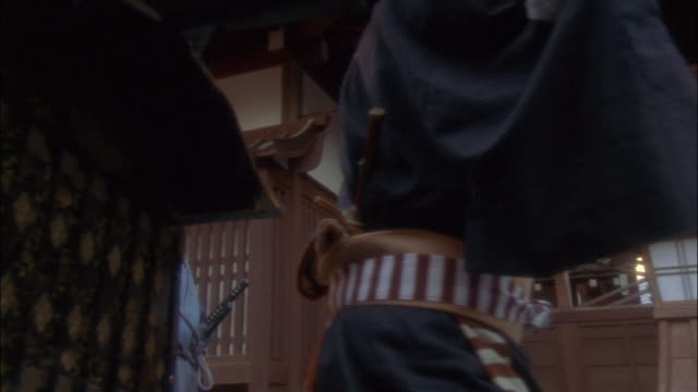 reenactment wide shot palanquin being carried into courtyard in procession / subjects kneeling / japan - 籠点の映像素材/bロール