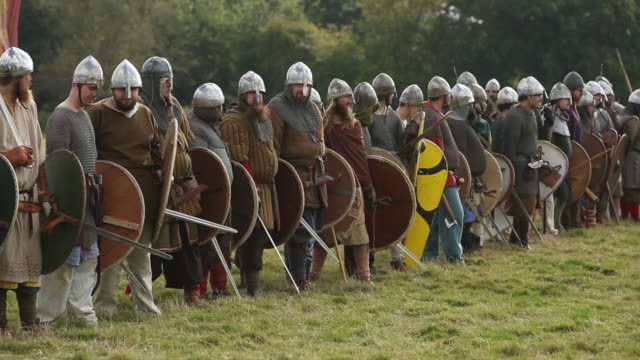 reenactors have gathered on the site of the 1066 battle to mark the 950th anniversary of the battle between the normanfrench army of william the duke... - battle of hastings stock videos & royalty-free footage