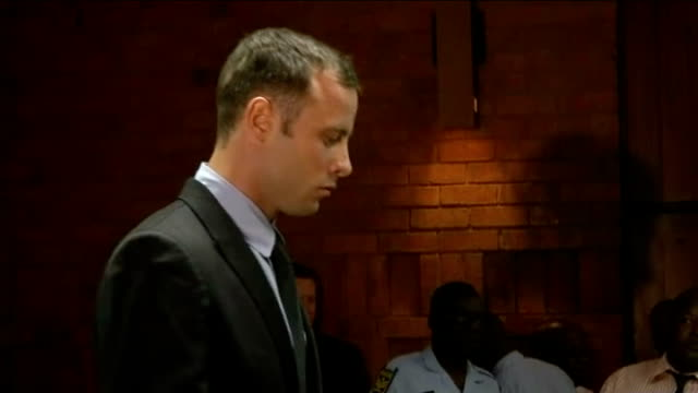 reeva steenkamp death oscar pistorius bail hearing day 2 south africa pretoria int ***flash oscar pistorius enters courtroom pistorius' hands crossed... - オスカー・ピストリウス点の映像素材/bロール