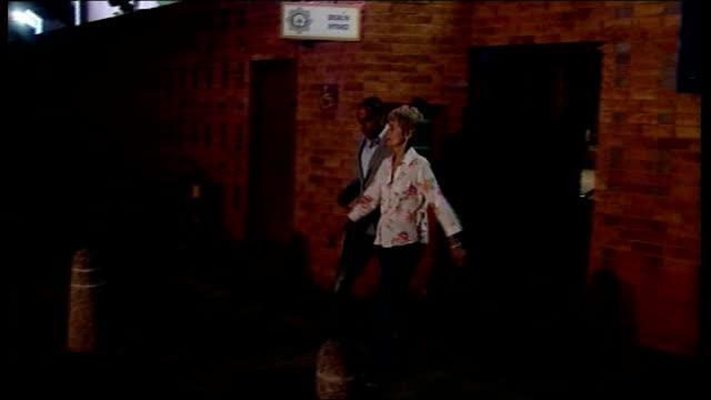 reeva steenkamp death oscar pistorius prepares for bail hearing south africa pretoria ext / night 'south african police service' sign on wall olga... - リーバ・スティンカンプ点の映像素材/bロール