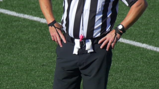 A referee at an American football game. - Slow Motion