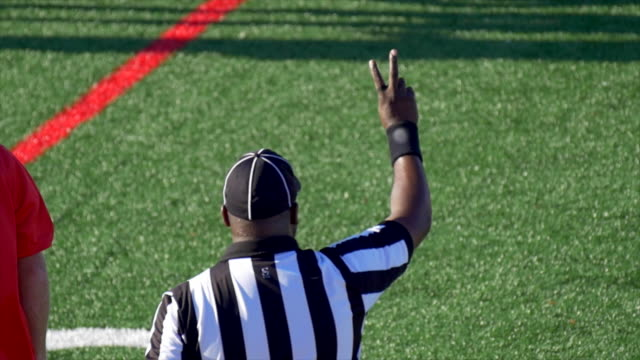 a referee at an american football game. - slow motion - referee stock videos & royalty-free footage