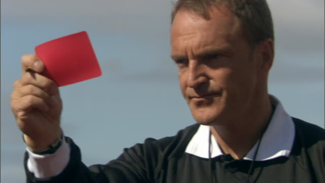vidéos et rushes de cu referee blowing whistle and giving player a red card during soccer game/ sheffield, england - authority