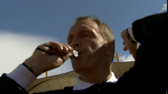 la cu referee blowing whistle during soccer game/ sheffield, england - trillerpfeife stock-videos und b-roll-filmmaterial