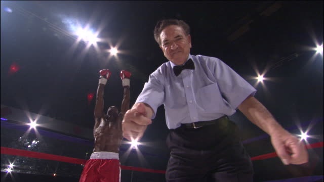 la pov ms cu referee counting down after knockout, then boxer taunts camera / jacksonville, florida, usa - referee stock videos & royalty-free footage