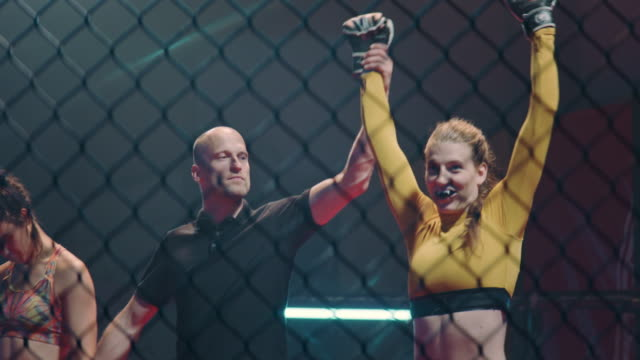 referee declairing the winner after the mma female fight. inside octagon - octagon stock videos & royalty-free footage