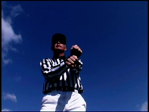referee gesturing outdoors - one mid adult man only stock videos & royalty-free footage
