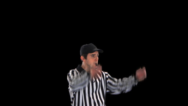 referee giving touchdown signal close-up - this clip has an embedded alpha-channel - pre matted stock videos & royalty-free footage