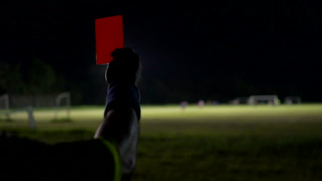 referee hands showing red card : slow motion - referee stock videos & royalty-free footage