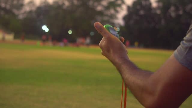 referee holding stopwatch in stadium - team sport stock videos & royalty-free footage