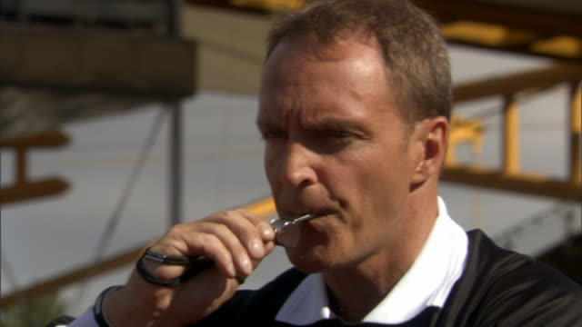 vidéos et rushes de cu referee looking at watch and blowing whistle during soccer game/ sheffield, england - gouvernement