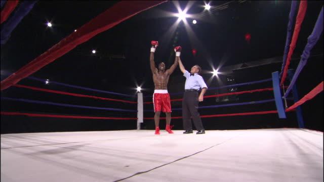 LA WS ZI MS Referee raising boxer's arm after winning match / Jacksonville, Florida, USA