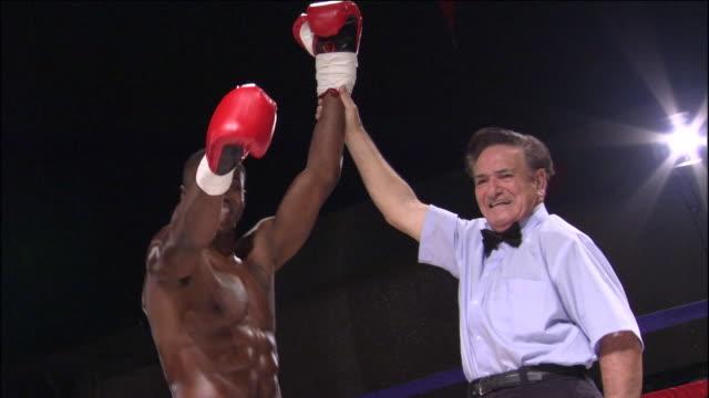 LA MS ZO WS Referee raising boxer's arm after winning match / Jacksonville, Florida, USA