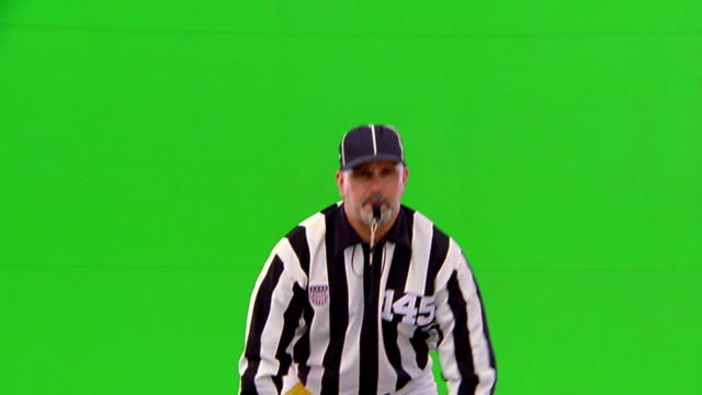 chroma key referee with whistle in mouth signaling field goal / touchdown - trillerpfeife stock-videos und b-roll-filmmaterial