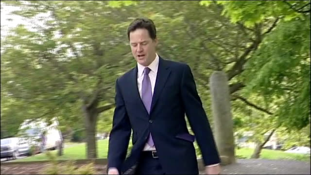 av referendum and local elections take place nick clegg voting england yorkshire sheffield ext nick clegg mp along down steps and into polling... - place sign stock videos & royalty-free footage