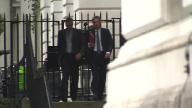 mps leave downing street by back gate england london downing street ext philip hammond mp down steps and away / patrick mcloughlin mp down steps and... - patrick mcloughlin stock videos and b-roll footage