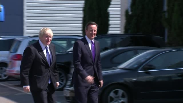 boris johnson backs campaign to leave eu lib / 2242015 surbiton david cameron and boris johnson arriving to visit nursery school / tx london downing... - デビッド・キャメロン点の映像素材/bロール