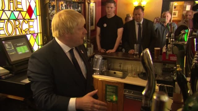 boris johnson visits darlington england county durham darlington int boris johnson mp pulling pint in pub and drinking boris johnson mp interview sot - pint glass stock videos & royalty-free footage