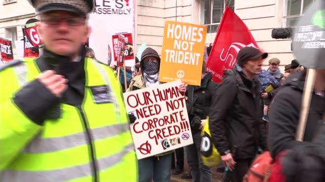 eu referendum campaign / anti austerity march in london england london ext various of antiausterity protesters gathering in street ahead of protest... - protestor stock videos & royalty-free footage