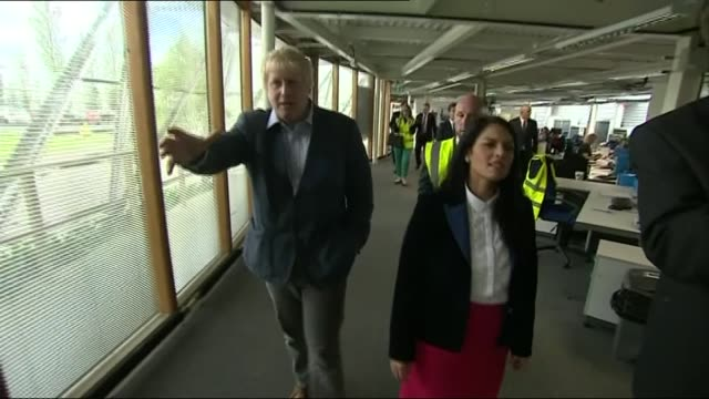 boris johnson and priti patel campaign together patel and johnson looking at uniforms and chatting sot / boris johnson posing for photographs with... - laura kuenssberg stock-videos und b-roll-filmmaterial