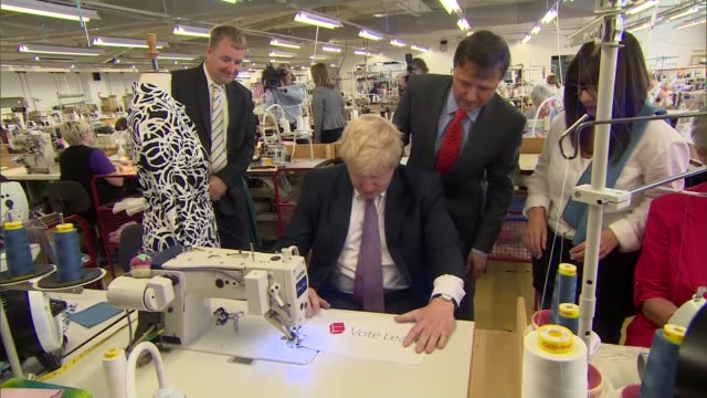 referendum campaign: boris johnson clothing tour and speech cutaways; england: derbyshire: alfreton int geneal views of clothing factory workers /... - referendum stock videos & royalty-free footage