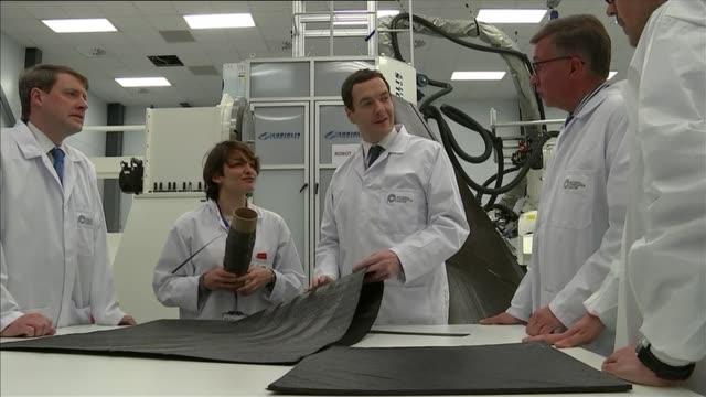 referendum campaign: george osborne speech cutaways; england: bristol: national composites centre: int george osborne mp in white lab coat tours ncc... - mp stock videos & royalty-free footage