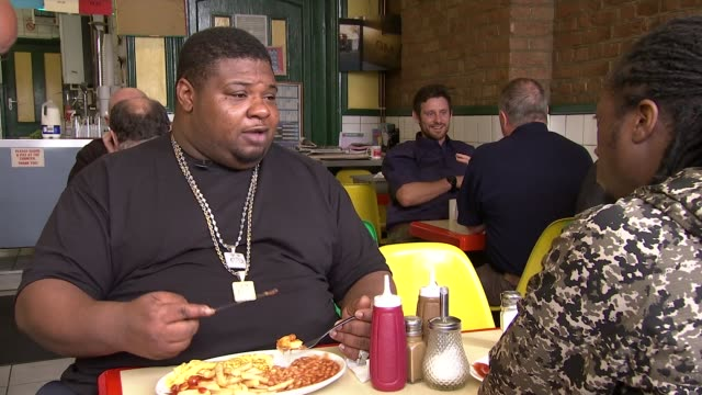 How is the grime music scene affected by Brexit Tomato sauce being poured onto plate Big Narstie setup shot / interview SOT Picture of hamburger on...