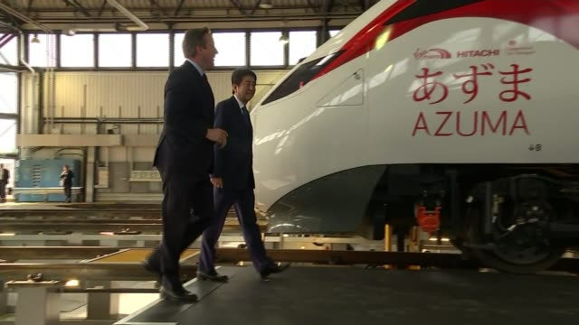 japanese prime minister backs britain remaining in the european union england london cameron and abe along to look at train during visit to north... - 国民投票点の映像素材/bロール
