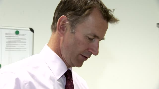 referendum campaign: jeremy hunt warns of risks to nhs if britain leaves eu; lib / 9.9.2015 london: jeremy hunt mp being shown medical equipment... - referendum stock videos & royalty-free footage
