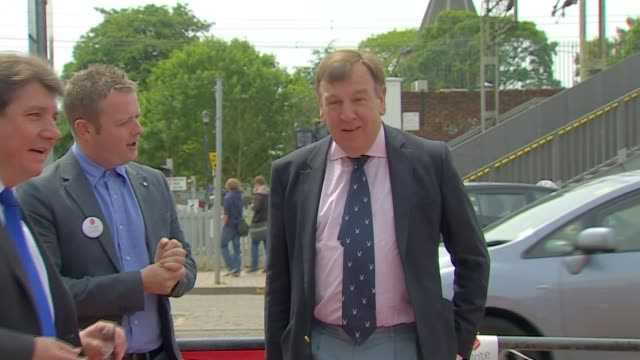 john whittingdale campaigning in thurrock england essex thurrock ext leave battlebus arriving / john whittingdale mp disembarking and meeting... - thurrock stock videos and b-roll footage
