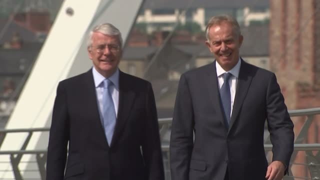 referendum campaign: labour aim to help boost support for 'remain'; northern ireland: londonderry : ext sir john major and tony blair chatting on... - all shirts stock-videos und b-roll-filmmaterial