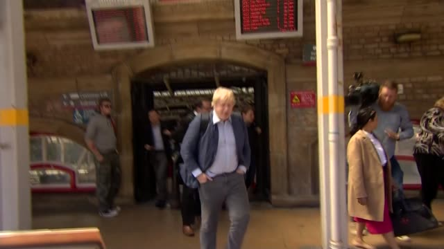 leave campaign proposes new immigration policy england lancashire preston ext boris johnson mp and priti patel mp along sign 'preston station' tilt... - michael gove stock-videos und b-roll-filmmaterial
