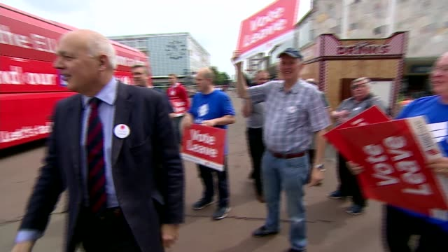 referendum campaign: leave: iain duncan smith in harlow; england: essex: harlow: ext vote leave battle bus arriving / iain duncan smith mp from bus... - brexit stock videos & royalty-free footage