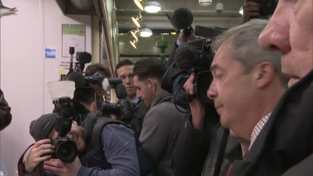 Leave Nigel Farage campaigning in Leeds Farage talking to people on fish stall / Farage posing people shouting NATSOT 'Give us our country back' /...