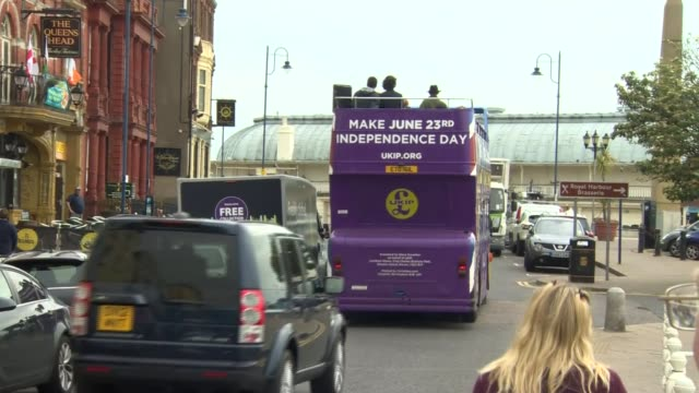 nigel farage campaigning in ramsgate england kent ramsgate ext **music heard sot** ukip battle bus along ends - ramsgate stock videos and b-roll footage