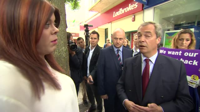 stockvideo's en b-roll-footage met nigel farage campaigning in ramsgate ext / int farage chatting to people inside butcher's shop farage chatting to various people in street / farage... - ramsgate