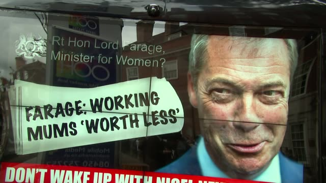 nigel farage poster van launch and bus tour of london **instrumental music playing sot** ukip bus arriving / convoy of poster trucks drive along - poster stock videos and b-roll footage