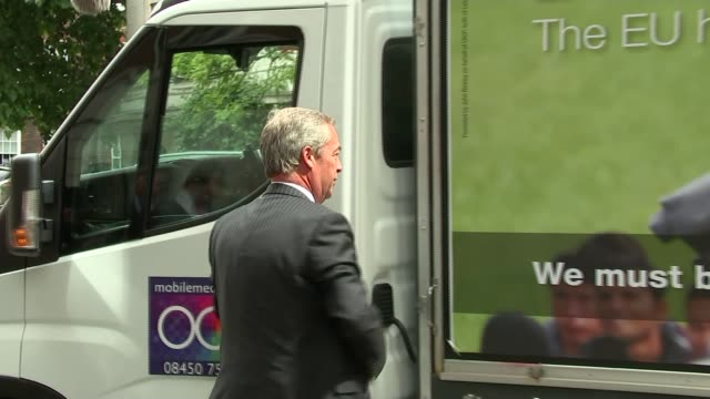 Nigel Farage says Jo Cox murder is being used to smear the Leave campaign TX ENGLAND London EXT Nigel Farage MEP getting out of van and along to pose...